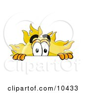 Clipart Picture Of A Sun Mascot Cartoon Character Peeking Over A Surface by Toons4Biz