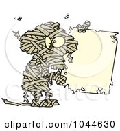 Cartoon Creepy Mummy Holding A Blank Sign
