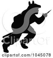 Black Silhouetted Native American Wearing A Fur And Hunting With A Spear