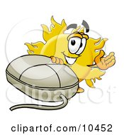 Sun Mascot Cartoon Character With A Computer Mouse