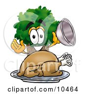 Clipart Picture Of A Tree Mascot Cartoon Character Serving A Thanksgiving Turkey On A Platter by Toons4Biz