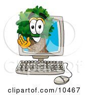 Clipart Picture Of A Tree Mascot Cartoon Character Waving From Inside A Computer Screen