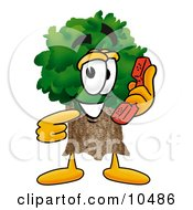 Clipart Picture Of A Tree Mascot Cartoon Character Holding A Telephone