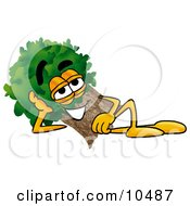 Clipart Picture Of A Tree Mascot Cartoon Character Resting His Head On His Hand by Toons4Biz