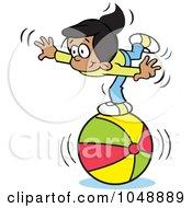 Hispanic Girl Balancing On A Beach Ball