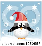 Christmas Penguin Wearing A Santa Hat In The Snow