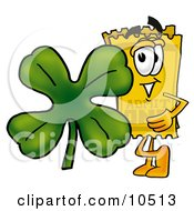 Yellow Admission Ticket Mascot Cartoon Character With A Green Four Leaf Clover On St Paddys Or St Patricks Day