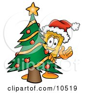 Clipart Picture Of A Yellow Admission Ticket Mascot Cartoon Character Waving And Standing By A Decorated Christmas Tree