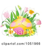 Pink And Yellow Easter Egg In A Bed Of Spring Flowers