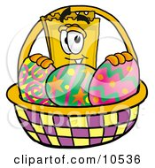 Yellow Admission Ticket Mascot Cartoon Character In An Easter Basket Full Of Decorated Easter Eggs