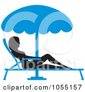 Silhouetted Woman Sun Bathing In A Lounge Chair