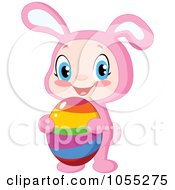 Easter Baby In A Bunny Costume And Holding An Egg