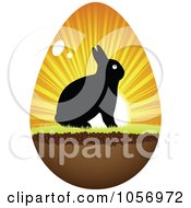 Royalty Free Vector Clip Art Illustration Of A Silhouetted Bunny And Sunset On An Easter Egg by Andrei Marincas