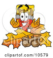 Clipart Picture Of A Paint Brush Mascot Cartoon Character With Autumn Leaves And Acorns In The Fall