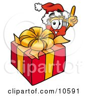 Clipart Picture Of A Paint Brush Mascot Cartoon Character Standing By A Christmas Present