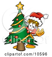 Paint Brush Mascot Cartoon Character Waving And Standing By A Decorated Christmas Tree
