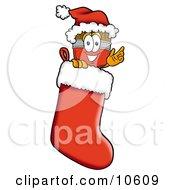 Paint Brush Mascot Cartoon Character Wearing A Santa Hat Inside A Red Christmas Stocking