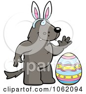 Clipart Wolf Wearing Bunny Ears By An Easter Egg Royalty Free Vector Illustration