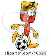 Clipart Picture Of A Paint Brush Mascot Cartoon Character Kicking A Soccer Ball