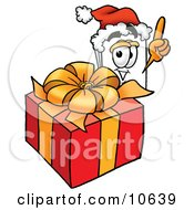 Clipart Picture Of A Paper Mascot Cartoon Character Standing By A Christmas Present