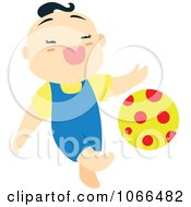 Asian Boy Kicking A Ball