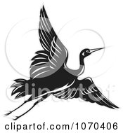 Clipart Black Crane In Flight Royalty Free Vector Illustration by patrimonio