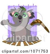 Clipart Happy Koala Holding A Boomerang Royalty Free Vector Illustration by bpearth