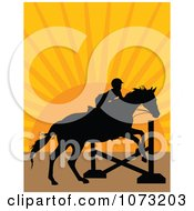 Silhouetted Equestrian And Horse Leaping A Hurdle At Sunset
