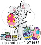 Clipart Gray Easter Bunny Painting Eggs Royalty Free Vector Illustration