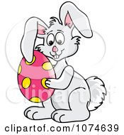 Clipart Gray Easter Bunny Holding An Egg Royalty Free Vector Illustration by Pams Clipart