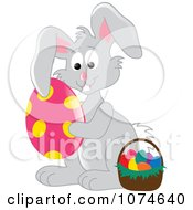 Clipart Gray Easter Bunny Hugging An Egg By A Basket 2 Royalty Free Vector Illustration