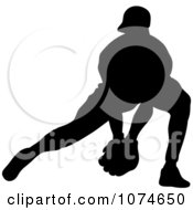 Silhouetted Baseball Player Reaching For A Ground Ball