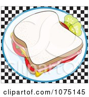 Ham Sandwich Garnished With Pickles On A Checkered Background