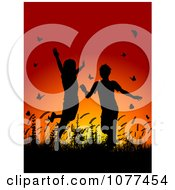 Clipart Silhouetted Children Playing In Grass And Butterflies At Sunset Royalty Free Vector Illustration by KJ Pargeter