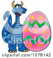 Clipart Blue Dragon School Mascot With An Easter Egg Royalty Free Vector Illustration