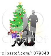Silhouetted Family Opening Christmas Gifts By A Tree