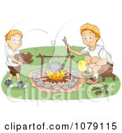 Boy Gathering Firewood And His Dad Boiling Water On A Fire At Camp