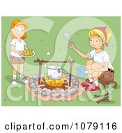 Camp Leader And Girl Cooking Over A Camp Fire