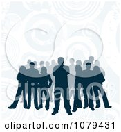 Silhouetted Group Of People On A Blue Grungy Circle Background