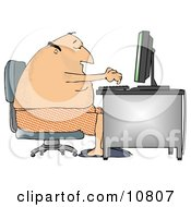 Man In His Boxers And Slippers Typing On A Computer At A Desk