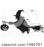 Black And White Woodcut Silhouetted Witch Flying On A Broomstick