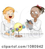 Male And Female Students Studying The Solar System In Science Class