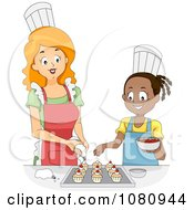 Home Economics Teacher Decorating Cupcakes With A Girl
