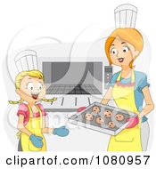 Home Economics Teacher And Girl Putting Cookies In An Oven