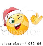 Clipart Winking Christmas Emoticon Smiley Face Wearing A Santa Hat Royalty Free Vector Illustration