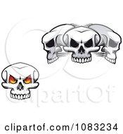 Clipart Fiery Eyed Skull And Three Skulls Royalty Free Vector Illustration