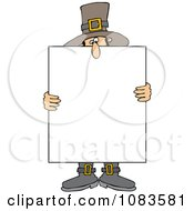 Pilgrim Holding A Thanksgiving Sign