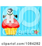 Snowman Sitting On A Cupcake Over Blue