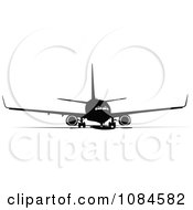 Clipart Black And Gray Commercial Airplane 6 Royalty Free Vector Illustration
