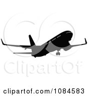 Clipart Black And Gray Commercial Airplane 5 Royalty Free Vector Illustration